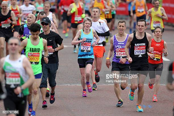 Runners pass Buckingham Palace during the Virgin Money London Marathon on April 24 2016 in London England