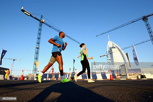 Runners pass Burj Al Arb during the Standard Chartered Dubai Marathon on January 23 2015 in Dubai United Arab Emirates