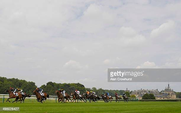 Runners pass the chateau de chantilly and turn into the straight in The Prix L'Equipe 21 at Chantilly racecourse on June 01 2014 in Chantilly France