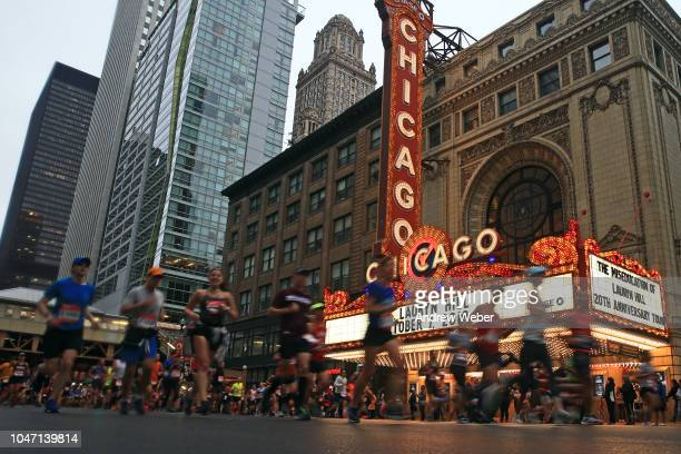 Runners pass the Chicago Theater during the 2018 Bank of America Chicago Marathon on October 7 2018 in Chicago Illinois