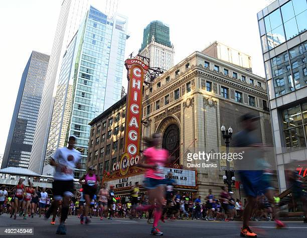 Runners pass the Chicago Theatre during the 2015 Bank of America Chicago Marathon on October 11 2015 in Chicago Illinois