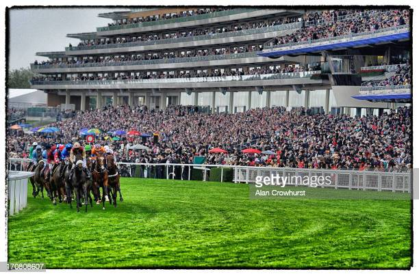 Runners pass the grandstand in the Ascot Stakes during day one of Royal Ascot at Ascot Racecourse on June 18 2013 in Ascot England