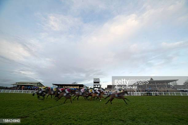 Runners pass the grandstands in The Thermolast Handicap Hurdle Race the last race of the day during the last meeting to be held at Hereford...