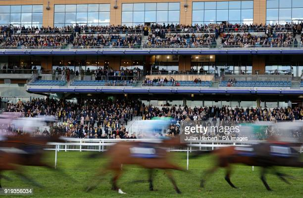 Runners pass the stands during The racingukcom/Clubdays Handicap Hurdle Race run during The Betfair Ascot Chase Raceday at Ascot Racecourse Esher