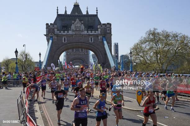 Runners pass the Tower of London during the 2018 London Marathon in central London on April 22 2018