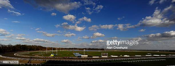 Runners pass the winning post with a circuit to go in The Book Now For Silver Cup Day National Hunt Flat Race at Kempton Park racecourse on February...
