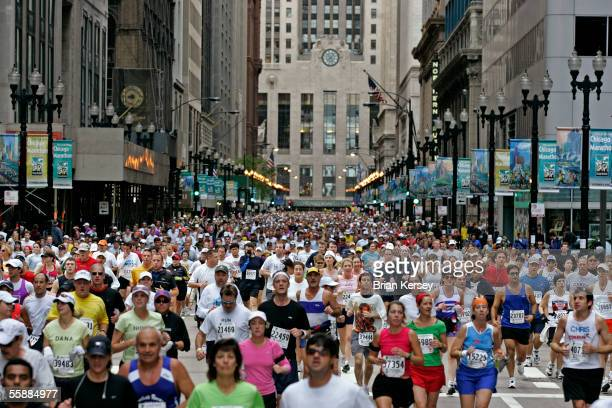 Runners pass through downtown during the 2005 LaSalle Bank Chicago Marathon October 9 in Chicago Illinois Kenyan Felix Limo won the race followed by...