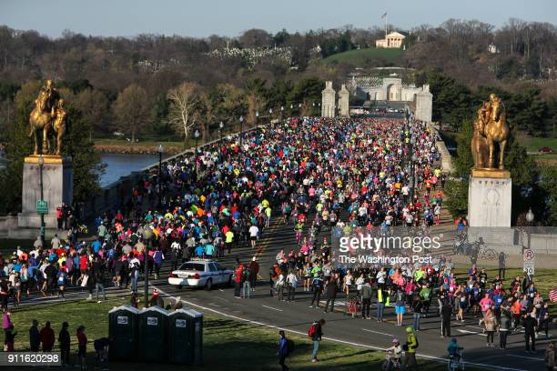 Runners pass through the Arlington Memorial Bridge during the Annual Cherry Blossom Ten Mile Run on April 2 2017 in Washington DC