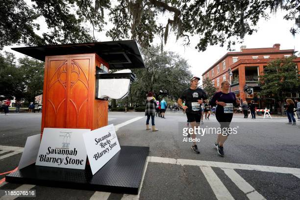 Runners passes the Savannah Blarney Stone during the Humana Rock 'n' Roll Savannah Marathon 1/2 Marathon on November 02 2019 in Savannah United States