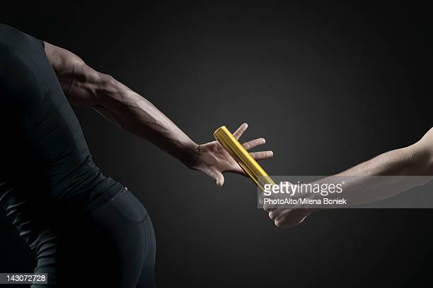 runners passing baton, cropped - human body part stock pictures, royalty-free photos & images