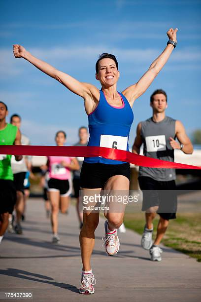 runners - finishing line stock pictures, royalty-free photos & images