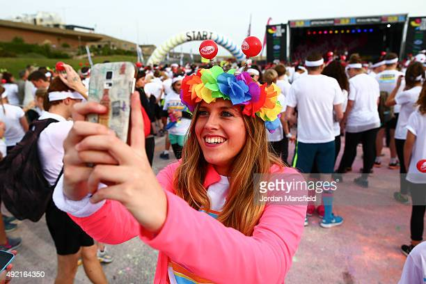 Runners prepare to take part in The Color Run on October 10 2015 in Brighton England The Color Run took place at Brighton's Madeira Drive on 10th...