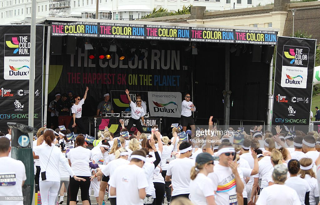 Runners prepare to take part in The Color Run presented by Dulux, known as the happiest 5km on the planet on September 14, 2013 in Brighton, England. Runners of all shapes, sizes and speeds start wearing white clothing that is a blank canvas for the kaleidoscope of colours they encounter around The Color Run course. At each kilometre a different colour of powder is thrown in the air with the runners becoming a constantly evolving artwork. At the end of the course runners are greeted by the Colour Festival where the air is filled with music and stunning coloured powder bursts creating a vibrant party atmosphere.