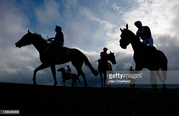 Runners pull up after finishing at Newmarket racecourse on April 18 2012 in Newmarket England