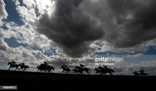 Runners pull up after finishing The NGK Spark Plugs EBF Maiden Filles' Stakes at Newmarket racecourse on April 18 2013 in Newmarket England