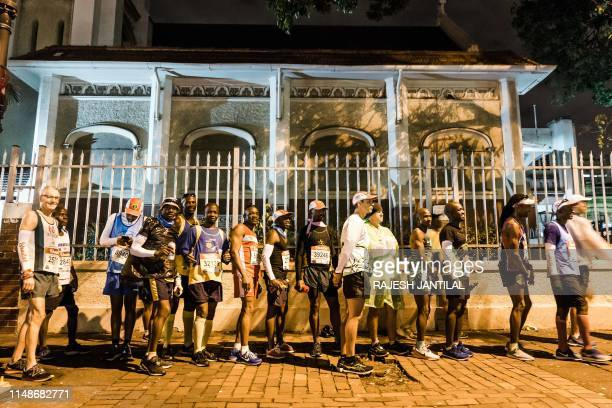 Runners queue before the start of the start of the 94th edition of the Comrades Marathon between Durban and Pietermaritzburg in Durban on June 9,...