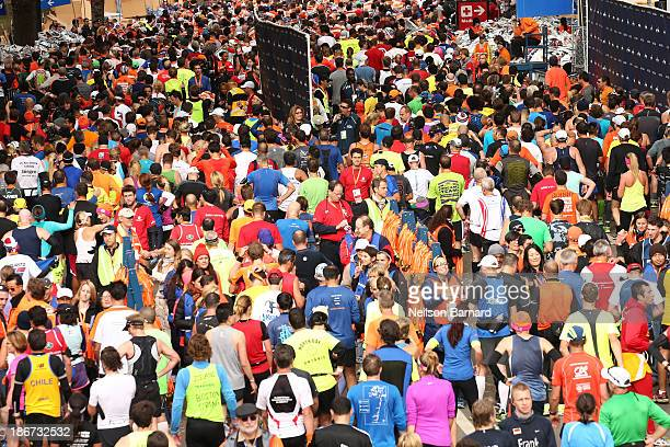 Runners queue for their finishing medals after crossing the finish line in Central Park during the 2013 ING New York City Marathon on November 3 2013...
