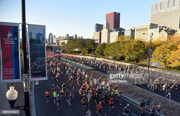 Runners race at the start of the 2015 Bank of America Chicago Marathon on October 11 2015 in Chicago Illinois
