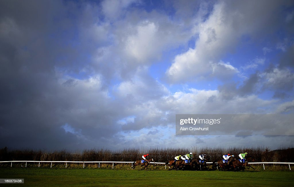 Runners race down the back straight in The Bet With The Ludlow On Course Bookmakers Mares' Handicap Hurdle Race at Ludlow racecourse on January 30, 2013 in Ludlow, England.