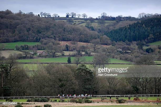Runners race down the back straight in The Jubilee Restaurant Maiden Hurdle Race at Ludlow racecourse on January 07 2015 in Ludlow England