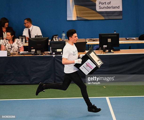 Runners race in with ballot boxes as the North East region European Union referendum count takes place on June 23 2016 in Sunderland United Kingdom...