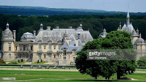 Runners race past the Chateau de Chantilly at Chantilly racecourse on June 02 2013 in Chantilly France