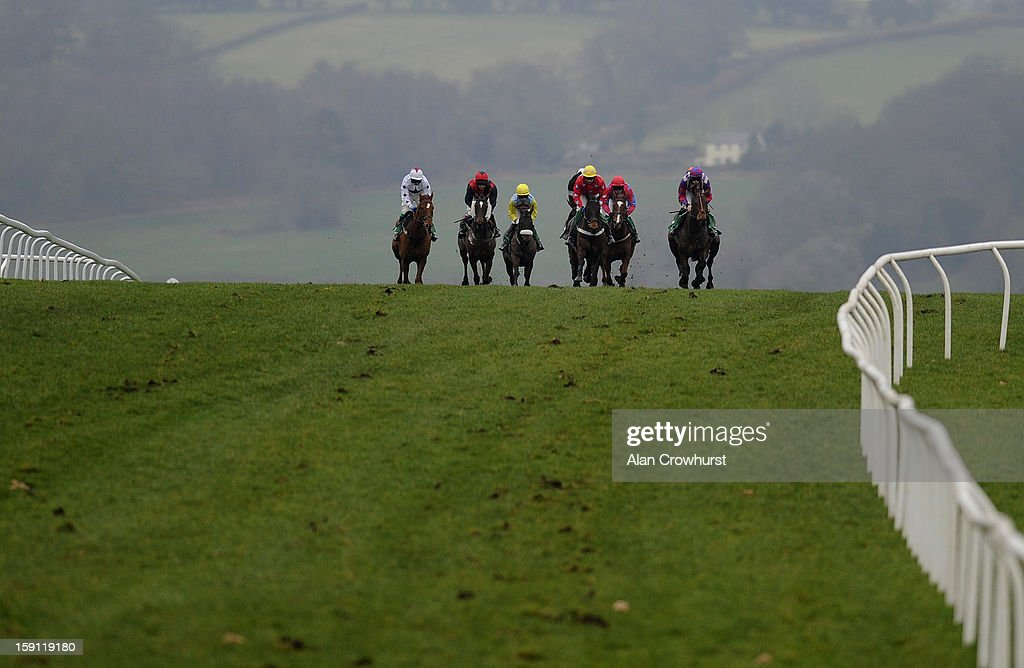 Runners race past the winning post with a circuit to go in The Morgan Cole LLP Novices' Handicap Hurdle Race at Chepstow racecourse on January 08, 2013 in Chepstow, Wales.