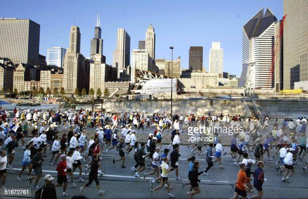 Runners race through Grant Park in downtown Chicago at the start of the 25th annual Chicago Marathon 13 October 2002 37500 runners registered for the...