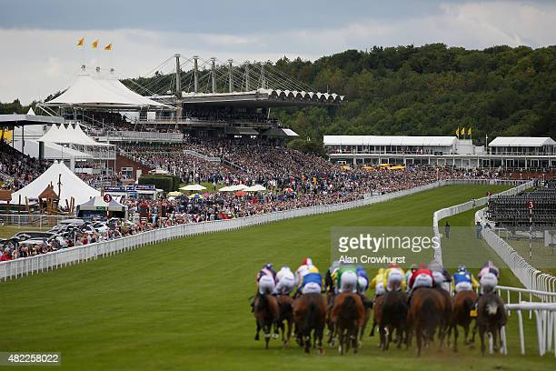 Runners race with four furlongs to go in The Victoria Racing Club Goodwood Stakes at Goodwood racecourse on July 29 2015 in Chichester England