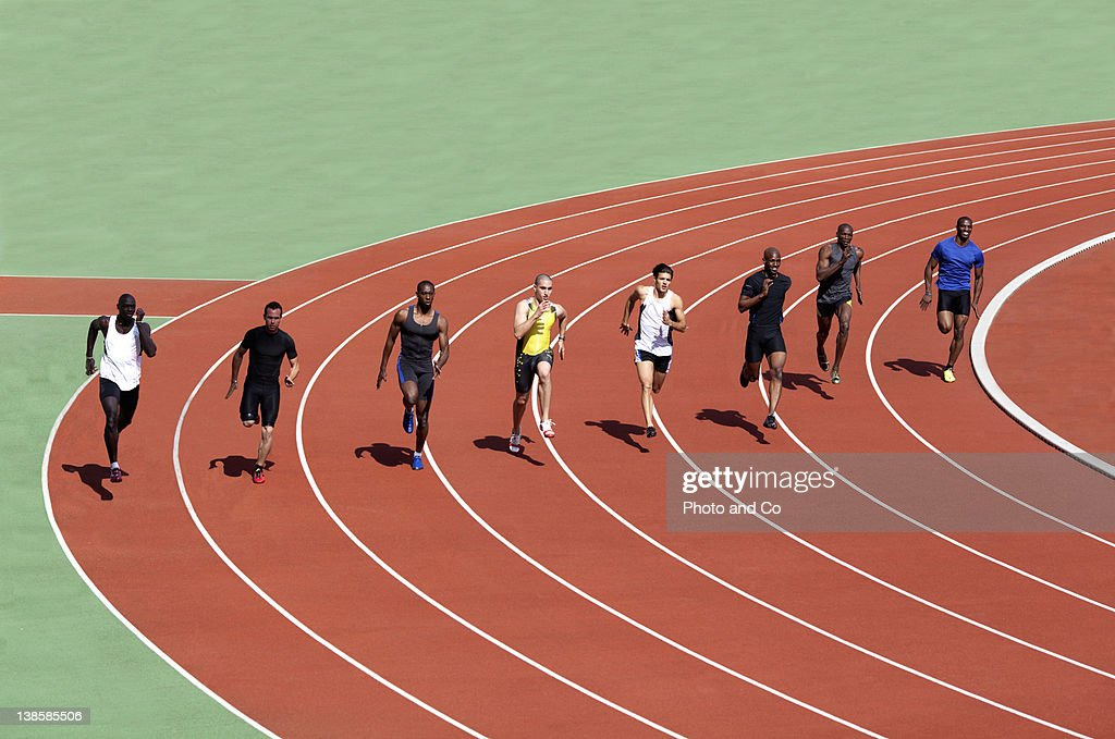 Runners racing on track : Stock Photo