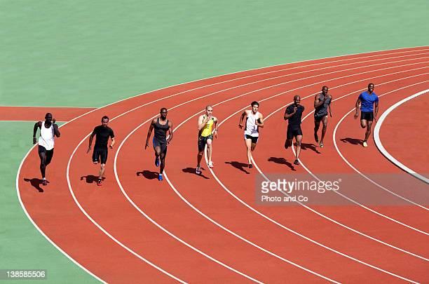 runners racing on track - 陸上競技 ストックフォトと画像