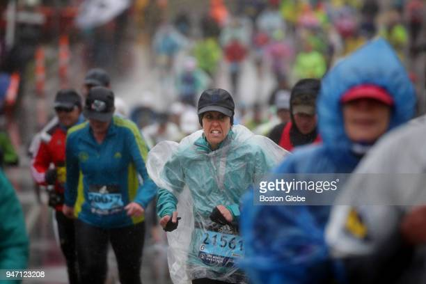 Runners reach Mile 21 after cresting Heartbreak Hill during the Boston Marathon in Newton Mass April 16 2018