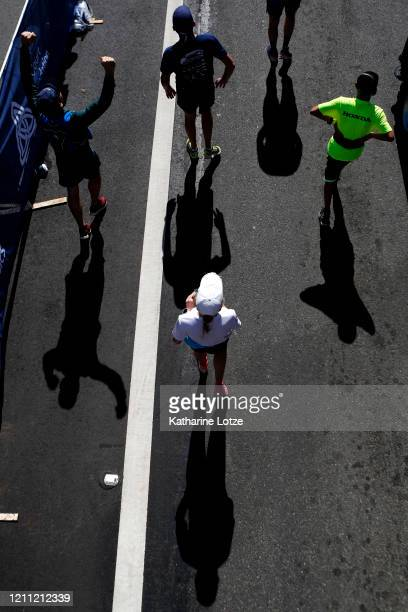 Runners react after crossing the finish line of the 2020 Los Angeles Marathon on March 08 2020 in Los Angeles California