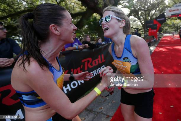 Runners react after finishing the Humana Rock 'n' Roll New Orleans 1/2 Marathon on February 09, 2020 in New Orleans, Louisiana.