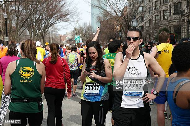 Runners react near Kenmore Square after two bombs exploded during the 117th Boston Marathon on April 15 2013 in Boston Massachusetts Two people are...