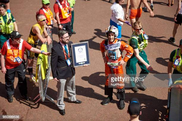Runners receive a Guinness Record Certificate during the Virgin Money London Marathon in London England on April 22 2018
