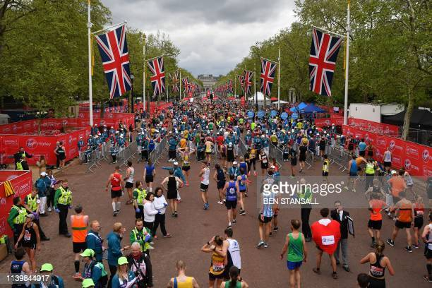 TOPSHOT Runners recover after running the 2019 London Marathon in central London on April 28 2019 / Restricted to editorial use sponsorship of...