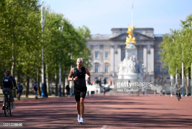 Runners run down The Mall where the finish of the London Marathon was due to take place on April 26 2020 in London England The 40th London Marathon...