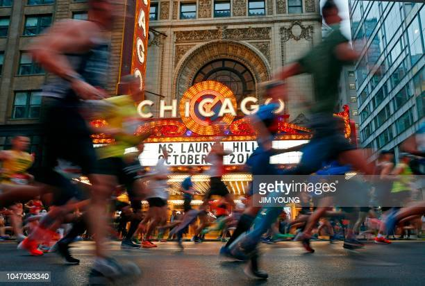 Runners run past the Chicago Theatre during the Chicago Marathon in Chicago on October 7 2018