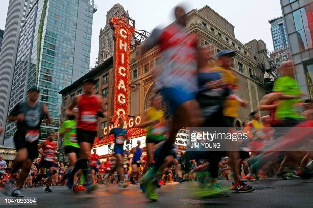 TOPSHOT Runners run past the Chicago Theatre during the Chicago Marathon in Chicago on October 7 2018