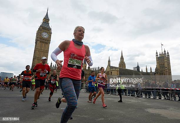 Runners run past the Houses of Parliament as they take part in the 2016 London Marathon in central London on April 24 2016 / AFP / NIKLAS HALLE'N
