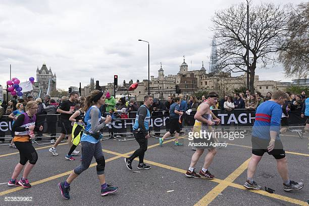 Runners run past Tower of London during the 2016 London Marathon in London United Kingdom on April 24 2016