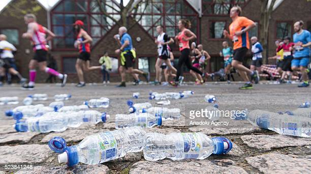 Runners run past water bottles as they take part in the 2016 London Marathon in London United Kingdom on April 24 2016