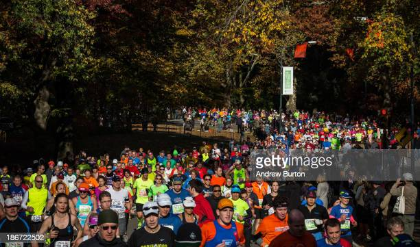 Runners run through Central Park while participating in the ING New York City Marathon on November 3 2013 in New York City With the Boston Marathon...