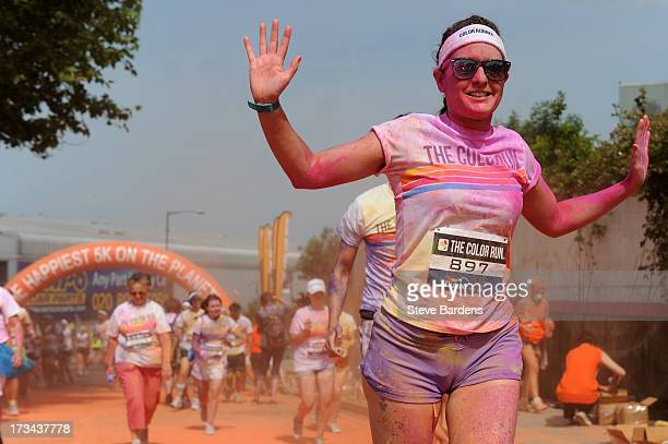 Runners run through the colour zone at The Color Run presented by Dulux known as the happiest 5km on the planet on July 14 in Wembley England Runners...