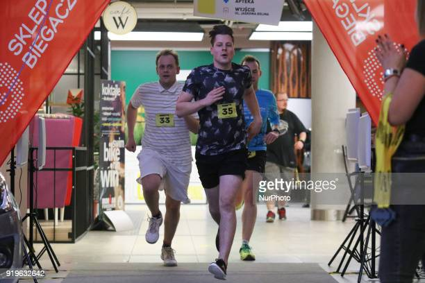 Runners running are seen in Gdansk Poland on 17 February 2018 Runners take part in the Manhattan Run run competition inside the Manhattan shopping...