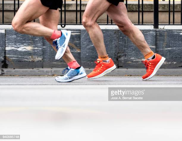 runners running fast in a career marathon for the city. - men's track stock pictures, royalty-free photos & images