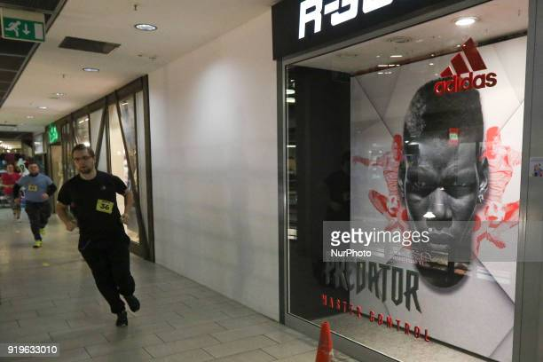 Runners running in front of Adidas shop are seen in Gdansk Poland on 17 February 2018 Runners take part in the Manhattan Run run competition inside...