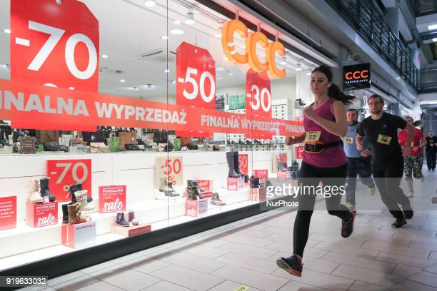 Runners running in front of CCC shop are seen in Gdansk Poland on 17 February 2018 Runners take part in the Manhattan Run run competition inside the...