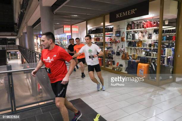 Runners running in front of Kemer shop are seen in Gdansk Poland on 17 February 2018 Runners take part in the Manhattan Run run competition inside...